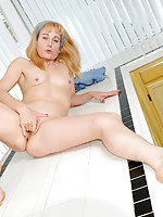 Milf with small tits plays with her mature pussy on top of kitchen counter